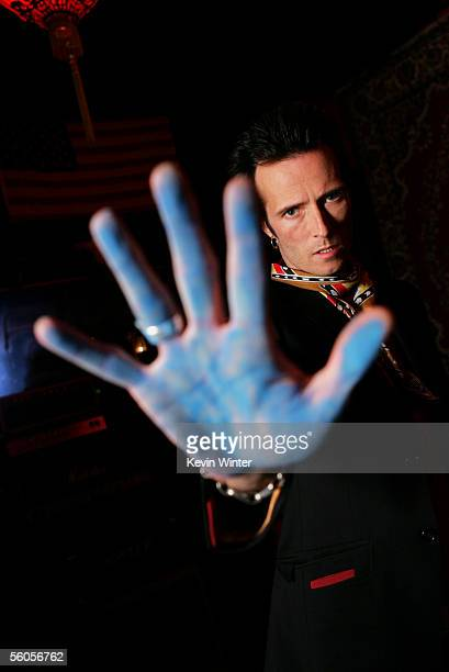 Scott Weiland of Velvet Revolver makes his handprint in the official book as they record and film the new disaster relief charity single a cover of...