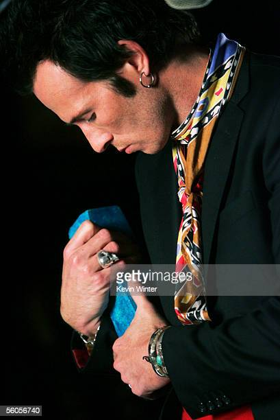 Scott Weiland of Velvet Revolver signs the symbolic blue brick as they record and film the video for the new disaster relief charity single a cover...