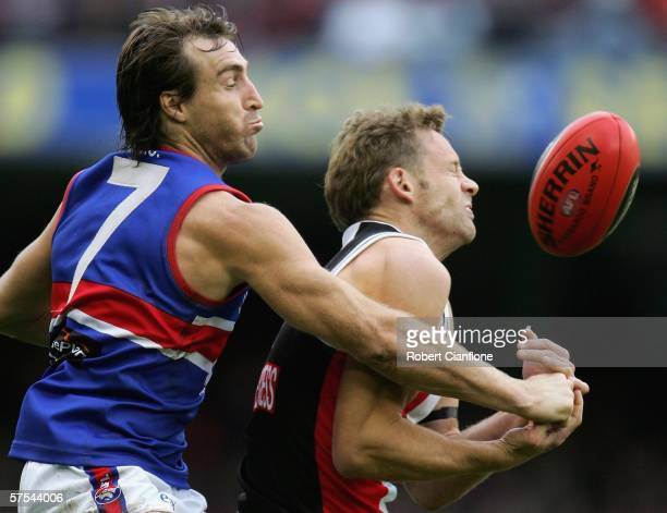 Scott West of the Bulldogs challenges Andrew Thompson of the Saints during the round six AFL match between the St Kilda Saints and the Western...