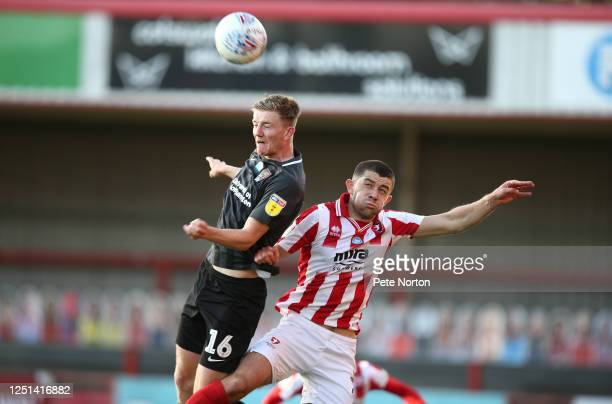 Scott Wharton of Northampton Town heads the ball away from Sean Long of Cheltenham Town during the Sky Bet League Two Play Off Semifinal 2nd Leg...