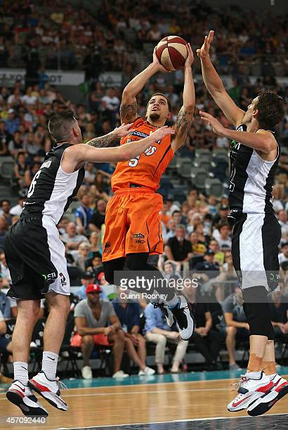 Scott Wilbekin of the Taipans shoots for the basket during the round one NBL match between Melbourne United and the Cairns Taipans at Hisense Arena...