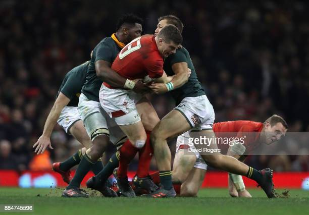 Scott Wiliams of Wales is tackled during the rugby union international match between Wales and South Africa at the Principality Stadium on December 2...