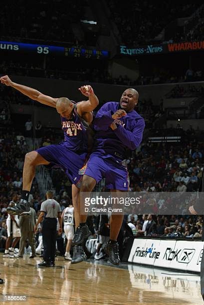Scott Williams and Alton Ford of the Phoenix Suns celebrate as they beat the San Antonio Spurs during the game at SBC Center on March 4 2003 in San...