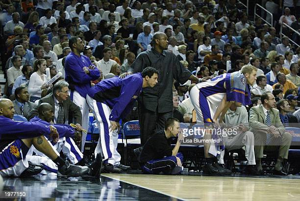 Scott Williams Bo Outlaw Tom Gugliotta Alton Ford and Jake Voskuhl of the Phoenix Suns watch the final seconds of their game against the San Antonio...
