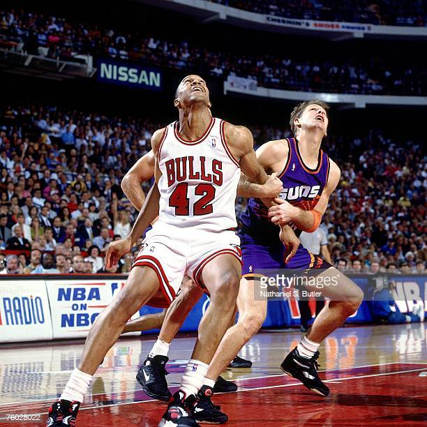 Scott Williams of the Chicago Bulls boxes out against Danny Ainge of the Phoenix Suns in Game Four of the 1993 NBA Finals on June 16 1993 at the...