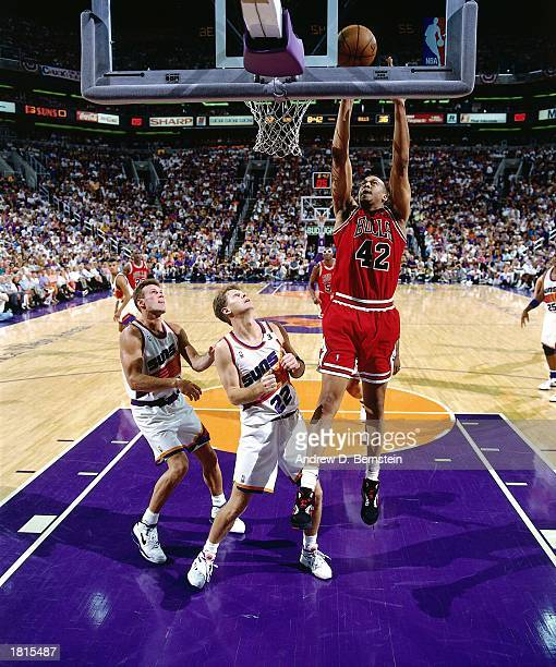 Scott Williams of the Chicago Bulls grabs a rebound against the Phoenix Suns during Game Six of the 1993 NBA Championship Finals at America West...