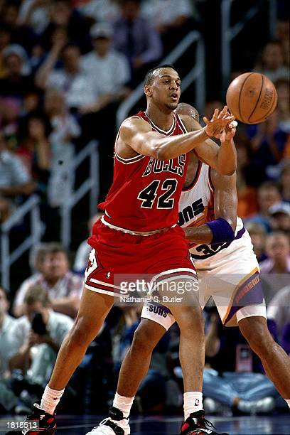 Scott Williams of the Chicago Bulls makes a pass against the Phoenix Suns during Game One of the 1993 NBA Championship Finals at America West Arena...