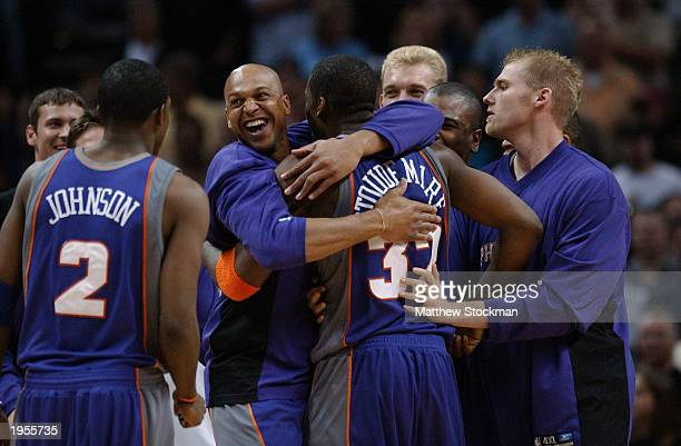 Scott Williams of the Phoenix Suns hugs Amare Stoudemire as fellow teammate Joe Johnson stands nearby in Game one of the Western Conference...