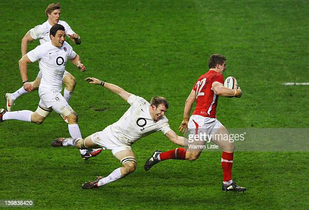 Scott Williams of Wales breaks past Tom Croft of England on the way to scoring his try during the RBS 6 Nations match between England and Wales at...