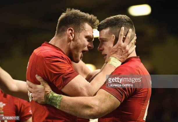 Scott Williams of Wales celebrates scoring his sides first try with Dan Biggar of Wales with during the International match between Wales and New...