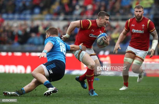 Scott Williams of Wales goes past the tackle from Pietro Ceccarelli of Italy during the RBS Six Nations match between Italy and Wales at the Stadio...