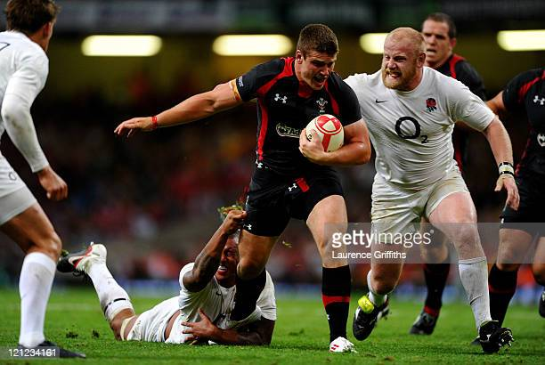 Scott Williams of Wales is snagged by Courtney Lawes of England during the rugby union international friendly match between Wales and England at the...