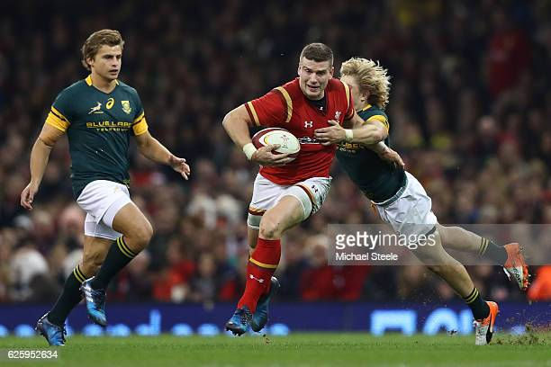 Scott Williams of Wales is tackled by Faf de Klerk of South Africa during the international match between Wales and South Africa at Principality...