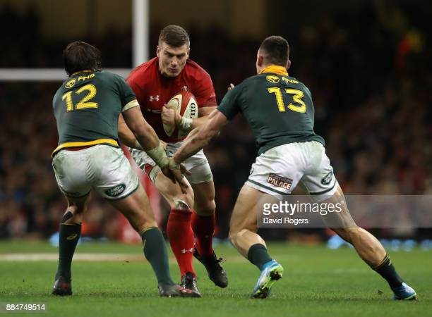 Scott Williams of Wales is tackled by Francois Venter and Jesse Kriel during the rugby union international match between Wales and South Africa at...
