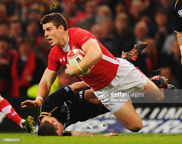 Scott Williams of Wales is tackled by Greig Laidlaw of Scotland during the RBS Six Nations match between Wales and Scotland at the Millenium Stadium...