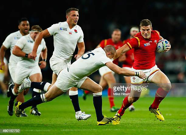 Scott Williams of Wales is tackled by Mike Brown of England during the 2015 Rugby World Cup Pool A match between England and Wales at Twickenham...