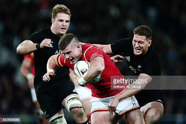 Scott Williams of Wales is tackled by Tawera KerrBarlow of New Zealand during the International Test match between the New Zealand All Blacks and...