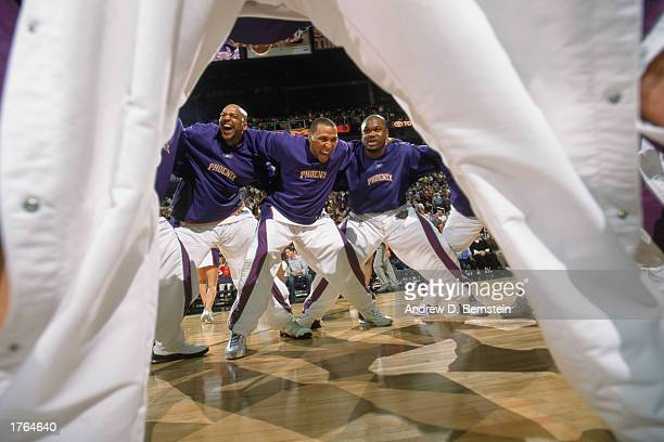 Scott Williams Shawn Marion and Alton Ford of the Phoenix Suns rally with their team during the game against the Los Angeles Lakers at America West...