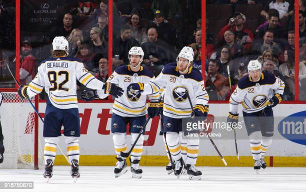 Scott Wilson of the Buffalo Sabres celebrates his first period goal against the Ottawa Senators with team mates Nathan Beaulieu Jason Pominville and...