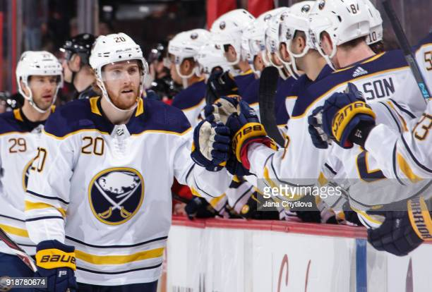 Scott Wilson of the Buffalo Sabres celebrates his first period goal against the Ottawa Senators with team mates on the bench at Canadian Tire Centre...
