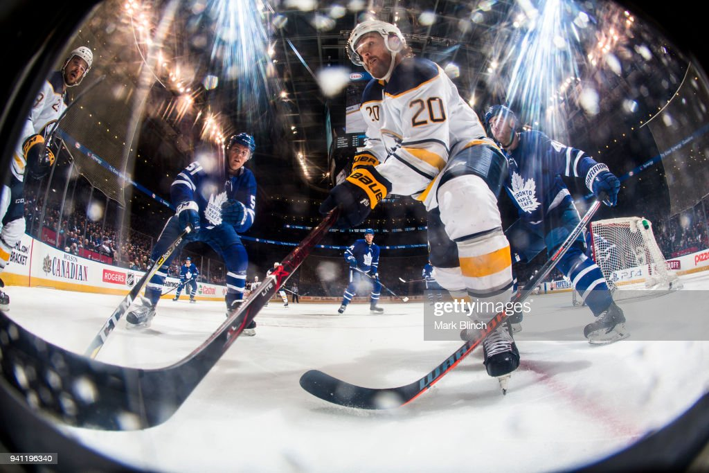 Scott Wilson #20 of the Buffalo Sabres skates against Jake Gardiner #51 and Roman Polak #46 of the Toronto Maple Leafs during the second period at the Air Canada Centre on April 2, 2018 in Toronto, Ontario, Canada.