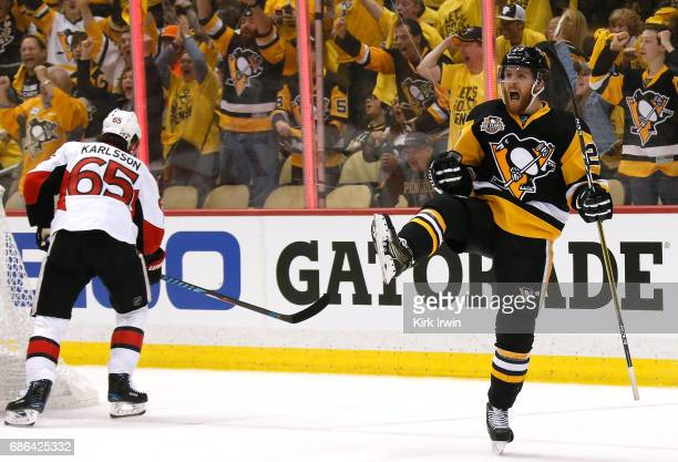 Scott Wilson of the Pittsburgh Penguins celebrates after scoring a goal against Craig Anderson of the Ottawa Senators during the first period in Game...
