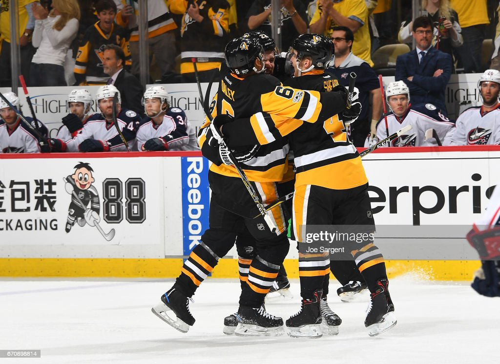 Scott Wilson #23 of the Pittsburgh Penguins celebrates his goal with Trevor Daley #6 of the Pittsburgh Penguins during the third period against the Columbus Blue Jackets in Game Five of the Eastern Conference First Round during the 2017 NHL Stanley Cup Playoffs at PPG Paints Arena on April 20, 2017 in Pittsburgh, Pennsylvania.