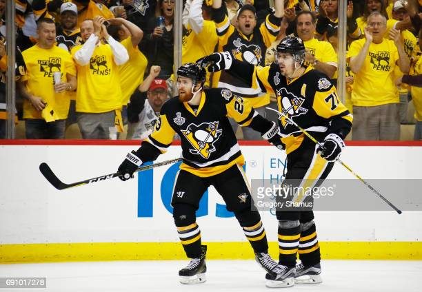 Scott Wilson of the Pittsburgh Penguins celebrates with Evgeni Malkin after scoring a goal during the third period in Game Two of the 2017 NHL...