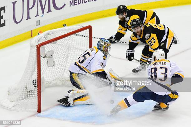 Scott Wilson of the Pittsburgh Penguins scores a goal past Pekka Rinne of the Nashville Predators during the third period in Game Two of the 2017 NHL...