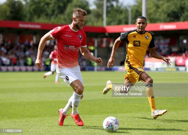 Scott Wiseman of Salford City runs with the ball during the Sky Bet League Two match between Salford City and Port Vale at Moor Lane on August 17...