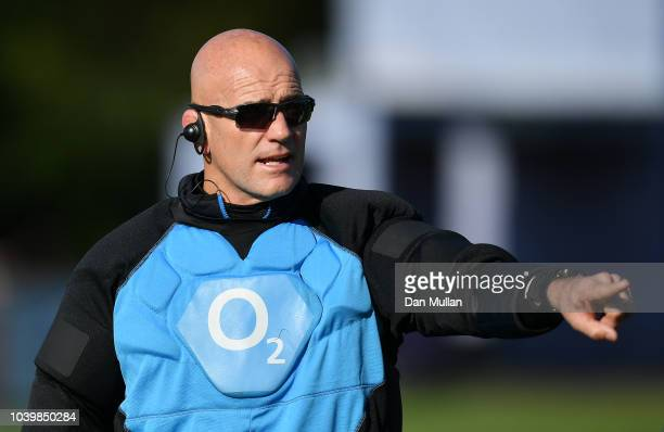 Scott Wisemantel Attack Coach of England issues instructions alongside Eddie Jones Head Coach of England during a training session at Clifton Rugby...