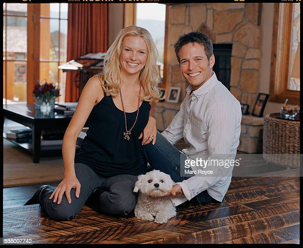 Scott Wolf and his wife Kelley Limp in thier Utah home with their Maltese dog Scooter