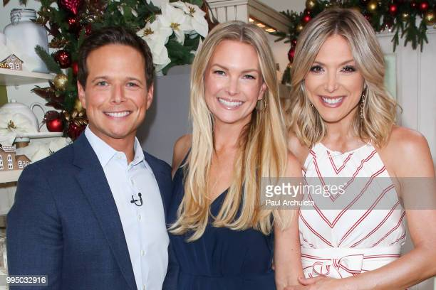 Scott Wolf Kelley Limp and Debbie Matenopoulos visit Hallmark's Home Family at Universal Studios Hollywood on July 9 2018 in Universal City California