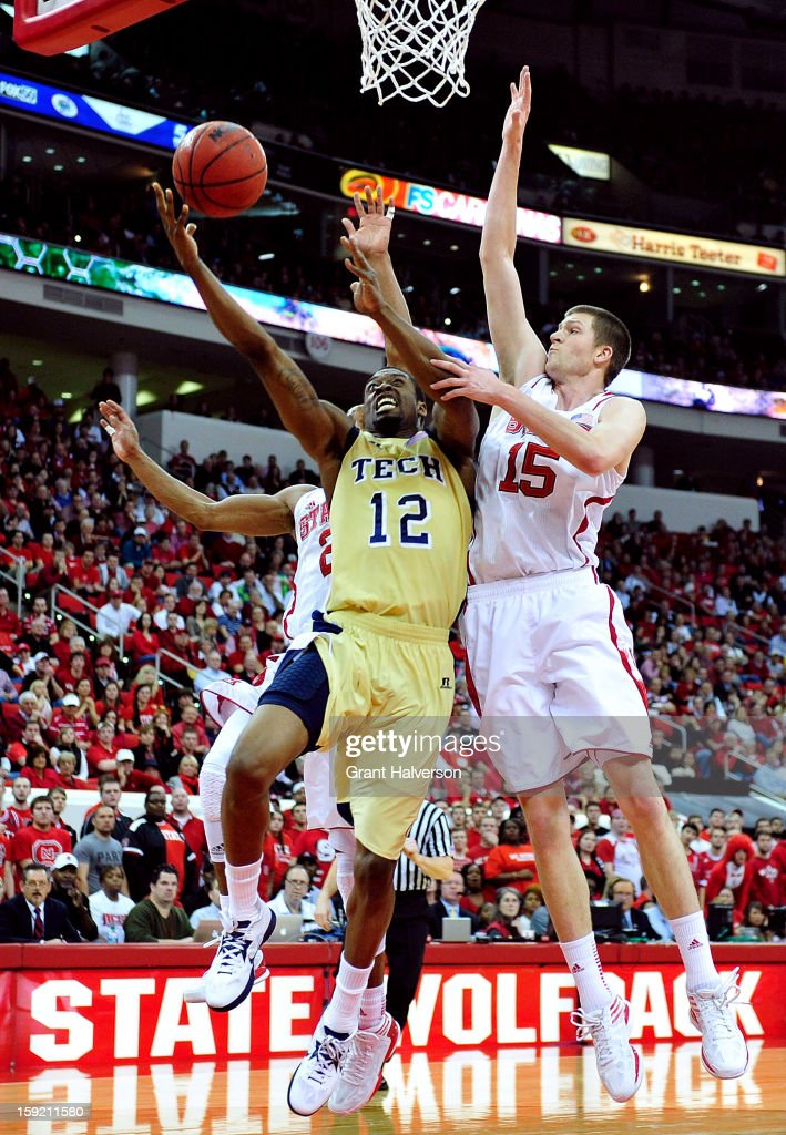 Scott Wood #15 of the North Carolina State Wolfpack defends a shot by Stacey Poole Jr.#12 of the Georgia Tech Yellow Jackets during play at PNC Arena on January 9, 2013 in Raleigh, North Carolina.
