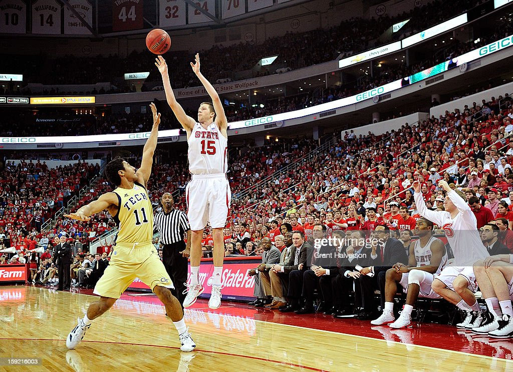 Scott Wood #15 of the North Carolina State Wolfpack launches a three-point shot over Chris Bolden #11 of the Georgia Tech Yellow Jackets during play at PNC Arena on January 9, 2013 in Raleigh, North Carolina. North Carolina State won 83-70.