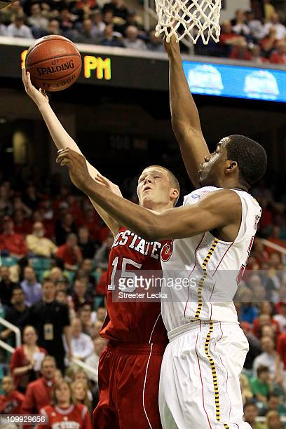 Scott Wood of the North Carolina State Wolfpack shoots against Dino Gregory of the Maryland Terrapins during the second half of the game in the first...