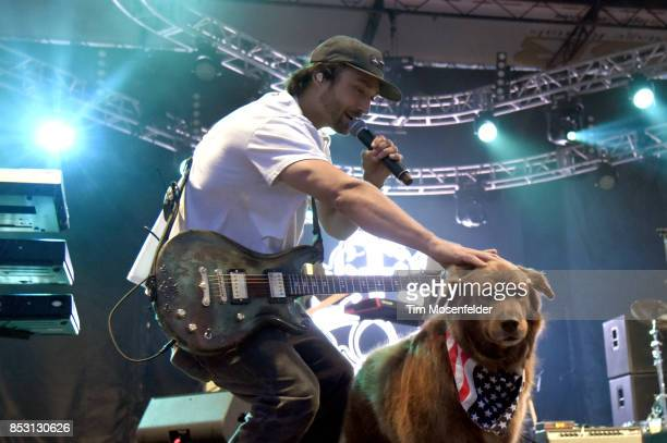 Scott Woodruff of Stick Figure and Cocoa the tour dog perform during the 2017 Life is Beautiful Festival on September 23 2017 in Las Vegas Nevada