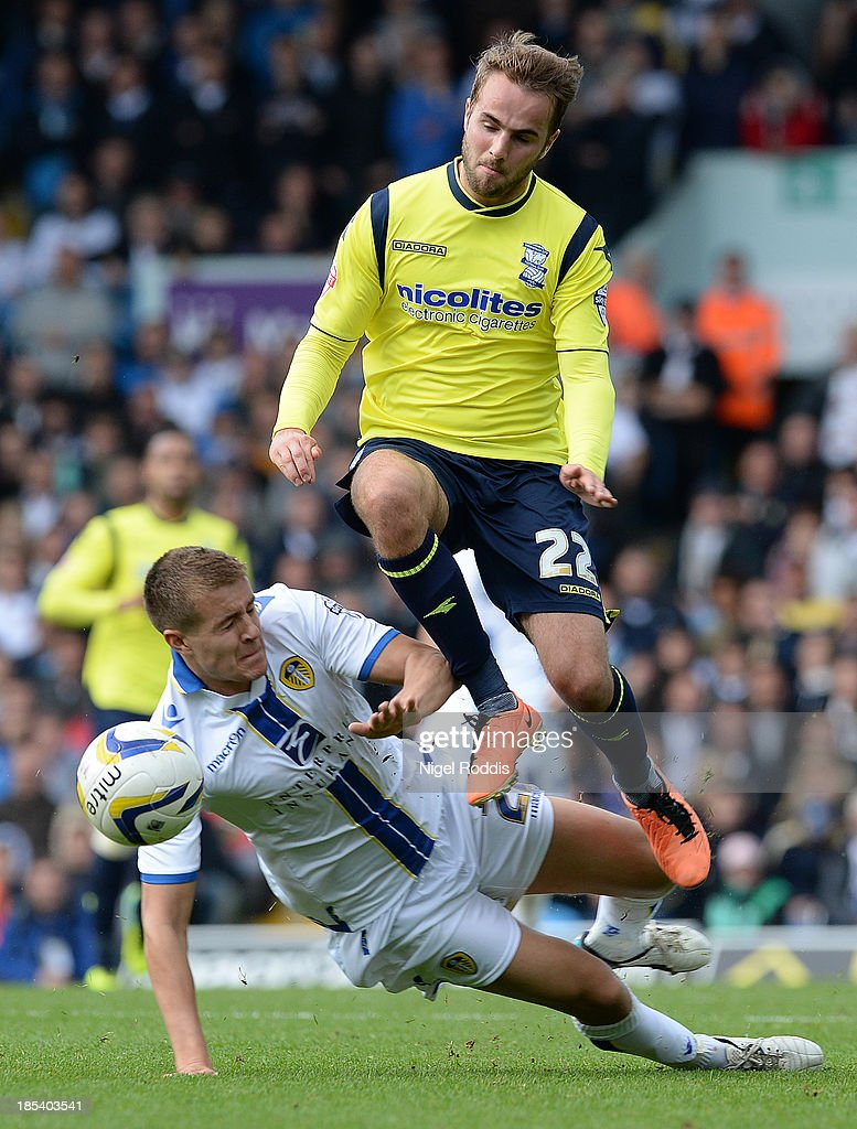 Scott Wooton (L) of Leeds United challenges Andrew Shinnie of Birmingham City during their Sky Bet Championship match between Leeds United and Birmingham City at Elland Road Stadium on October 20, 2013 in Leeds, England.