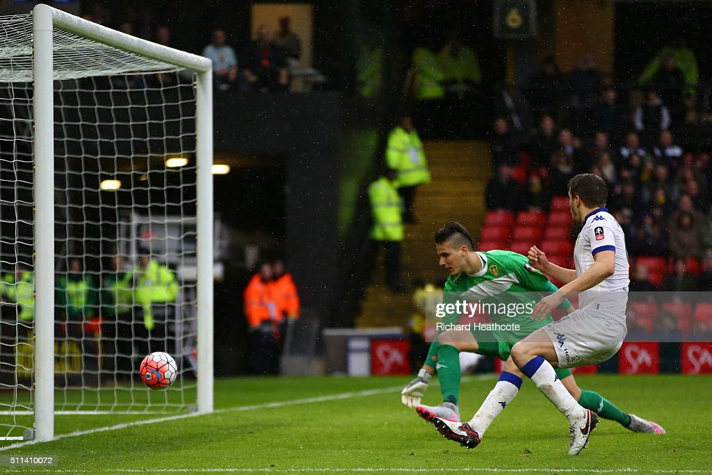 Scott Wootton (R) of Leeds United kicks the ball resulting in an own goal during the Emirates FA Cup fifth round match between Watford and Leeds United at Vicarage Road on February 20, 2016 in Watford, England.
