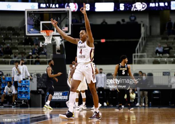 Scottie Barnes of the Florida State Seminoles reacts to a three point basket during the first half against the Colorado Buffaloes in the second round...