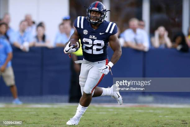 Scottie Phillips of the Mississippi Rebels runs with the ball during a game against the Alabama Crimson Tide at VaughtHemingway Stadium on September...
