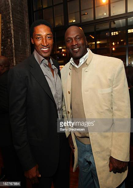 Scottie Pippen and Michael Jordan attend the surprise birthday celebration for Scottie Pippen at Sunda on September 24 2012 in Chicago Illinois