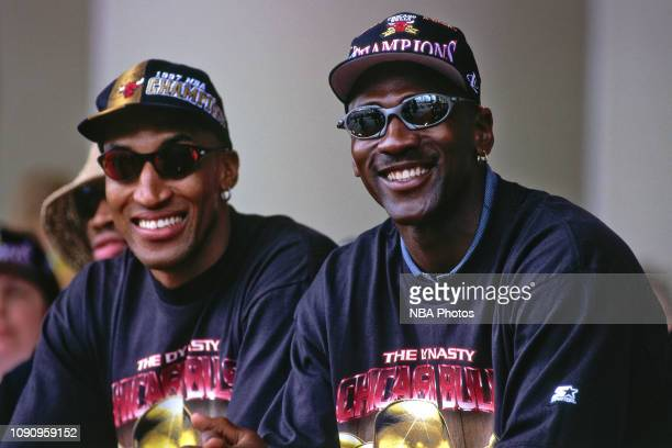 Scottie Pippen and Michael Jordan of the Chicago Bulls are seen smiling at the Chicago Bulls Championship Parade and Rally on June 16 1997 at Grant...
