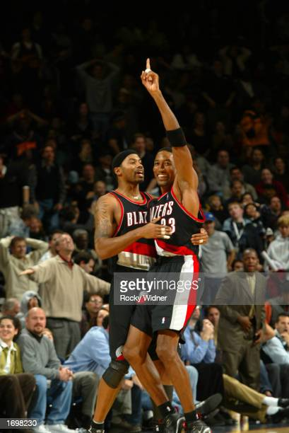 Scottie Pippen and Rasheed Wallace of the Portland Trail Blazers celebrate after Wallace made the game winning shot against the Golden State Warriors...