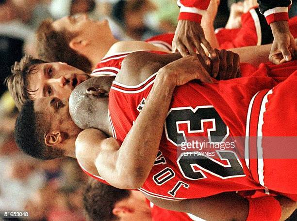 Scottie Pippen hugs Chicago Bulls teammate Michael Jordan at the end of game five of the 1997 NBA Finals 11 June at the Delta Center in Salt Lake...