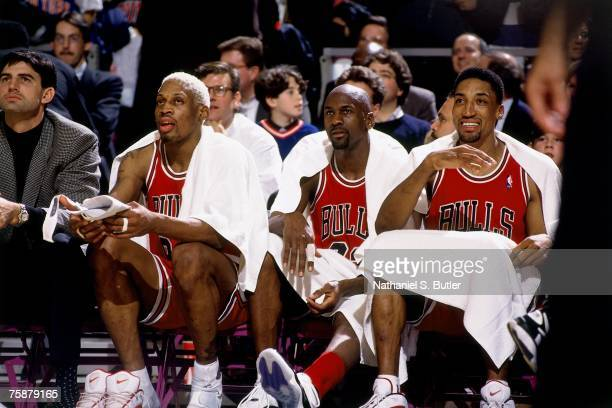 Scottie Pippen Michael Jordan and Dennis Rodman of the Chicago Bulls look on from the sidelines during a 1996 NBA Game NOTE TO USER User expressly...