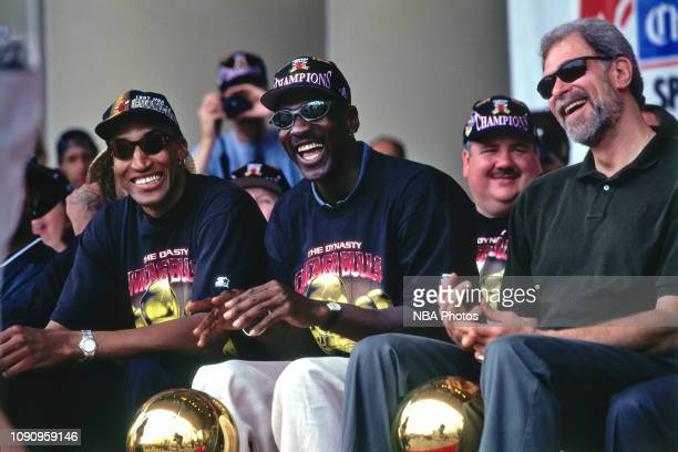 Scottie Pippen Michael Jordan and Head Coach Phil Jackson of Chicago Bulls are smiling at the Chicago Bulls Championship Parade and Rally on June 16...