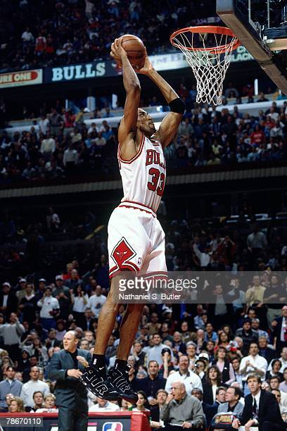 Scottie Pippen of the Chicago Bulls attempts a dunk against the Seattle SuperSonics during Game Two of the 1996 NBA Finals at the United Center on...