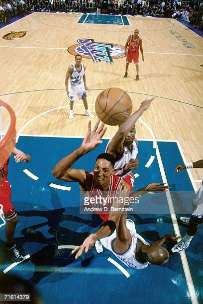 Scottie Pippen of the Chicago Bulls attempts a layup against Bryon Russell of the Utah Jazz during Game 2 of the 1998 NBA Finals played June 5 1998...