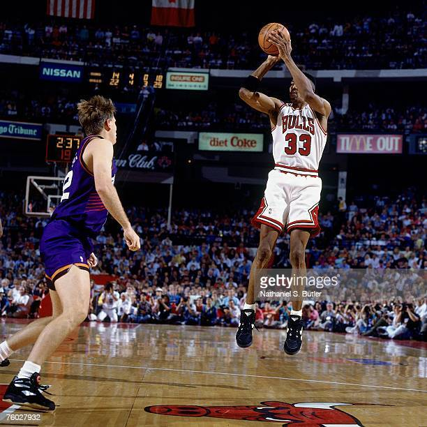 Scottie Pippen of the Chicago Bulls attempts a shot against Danny Ainge of the Phoenix Suns in Game Four of the 1993 NBA Finals on June 16 1993 at...